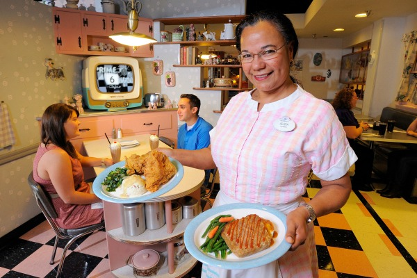 50's Prime Time Cafe Server with Food - Credit WDW Scott Miller