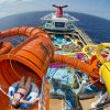 A guest onboard Carnival Vista slides down Kaleid-O-Slide, a water tube attraction situated amid WaterWorks, the ship's onboard water park. (Photo by Andy Newman/Carnival Cruise Line)