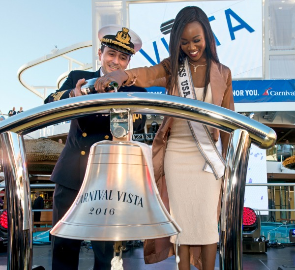 Carnival Vista captain Luigi De Angelis, left, and Miss USA Deshauna Barber, right, pour champagne over a ship's bell to name the new Carnival Vosta Friday , Nov. 4, 2016, in New York City. Barber is the ship's godmother and presided over naming ceremonies. The 1,062-foot-long Carnival Vista is scheduled to sail on 11-day voyages from New York before launching year-round six- and eight-day Caribbean cruises from Miami beginning Nov. 27. FOR EDITORIAL USE ONLY (Andy Newman/Carnival Cruise Line/HO)